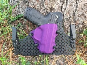 Bradford Tactical Purple half shell Holster on an ultimate backer