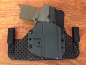 Renaissance Firearms half shell holster on an ultimate backer